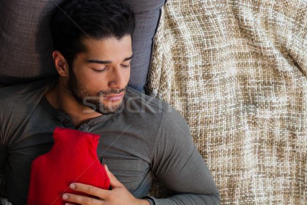 Man slapen heet water zak home water Stockfoto © wavebreak_media