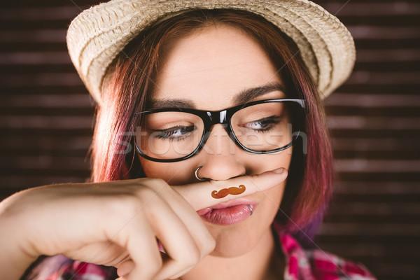 Bela mulher falsificação bigode parede de tijolos mulher beleza Foto stock © wavebreak_media
