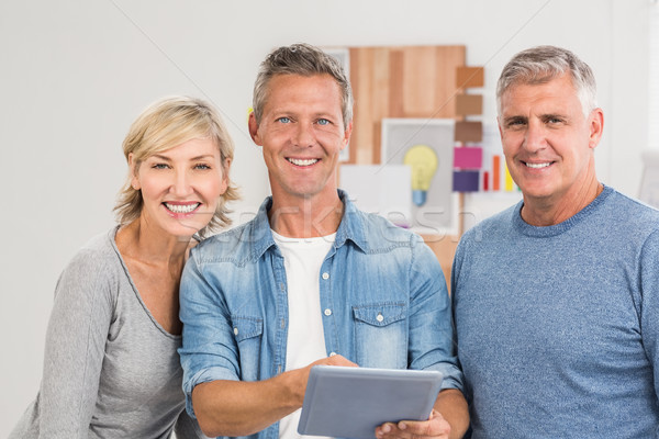 Smiling business colleagues working on a tablet Stock photo © wavebreak_media
