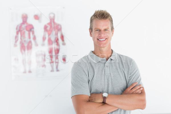Boldog orvos néz kamera keresztbe tett kar orvosi Stock fotó © wavebreak_media