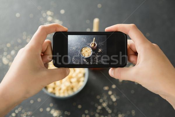 Hands taking photo of breakfast with mobile phone Stock photo © wavebreak_media