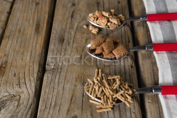 Three spoons with various breakfast cereals Stock photo © wavebreak_media