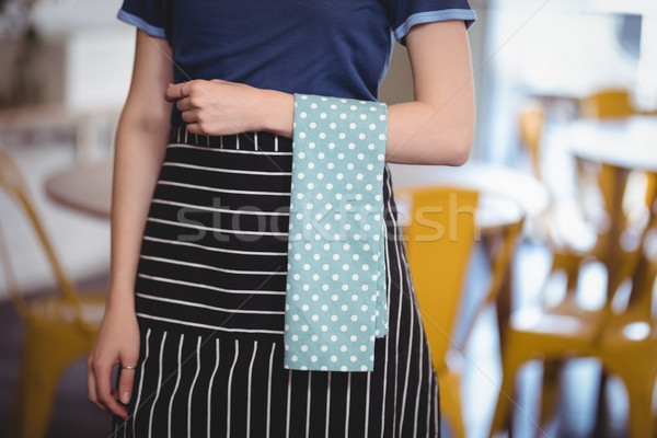 Midsection of young waitress with turquoise napkin at coffee shop Stock photo © wavebreak_media