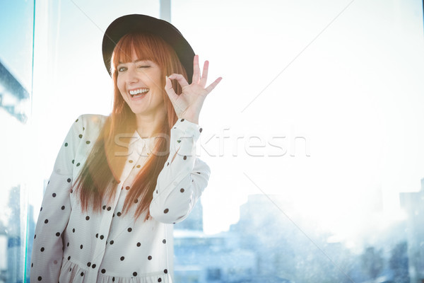 Smiling hipster woman making ok sign Stock photo © wavebreak_media