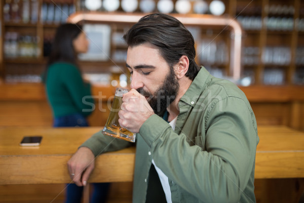 Man drinking glass of beer Stock photo © wavebreak_media