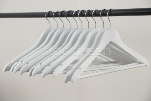 Hangers arranged on clothes rack Stock photo © wavebreak_media