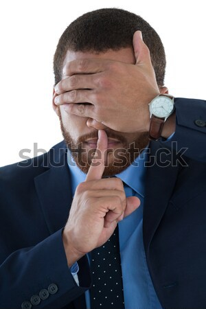 Businessman covering his eyes with finger on lips Stock photo © wavebreak_media
