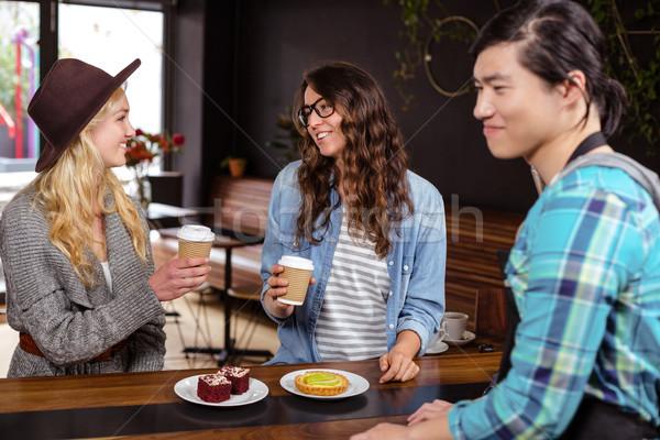 Smiling friends enjoying coffee and pastries Stock photo © wavebreak_media