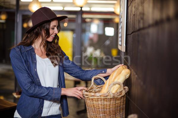 Smiling woman looking at bread Stock photo © wavebreak_media