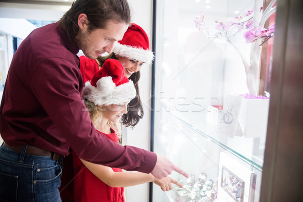 Family in Christmas attire looking at a display of wrist watch Stock photo © wavebreak_media