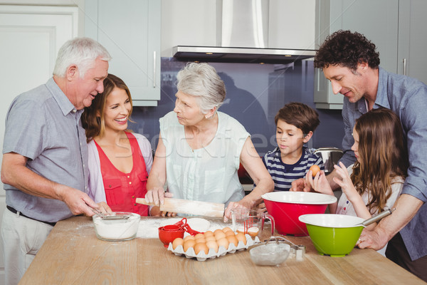 Happy family cooking food in kitchen Stock photo © wavebreak_media