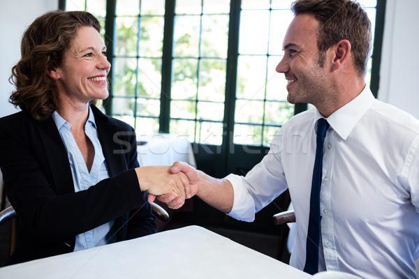 Business collega's handen schudden geslaagd vergadering restaurant Stockfoto © wavebreak_media