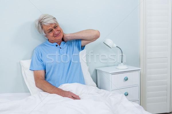 Kıdemli adam boyun ağrısı oturma yatak Stok fotoğraf © wavebreak_media