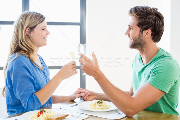 Fiatal pér pirít borospoharak étel otthon nő Stock fotó © wavebreak_media