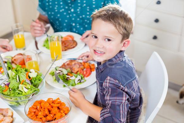 Jongen vergadering eettafel glimlachend portret Stockfoto © wavebreak_media