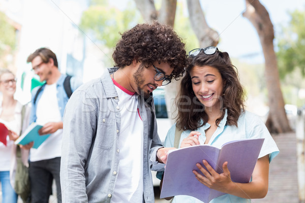 Students reading book Stock photo © wavebreak_media