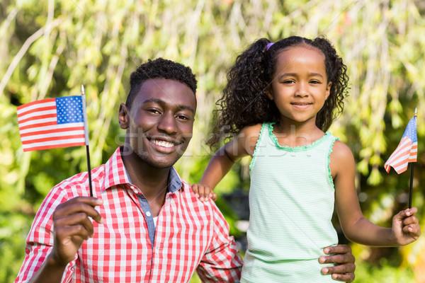Mutlu aile ABD bayrak sevmek çim Stok fotoğraf © wavebreak_media