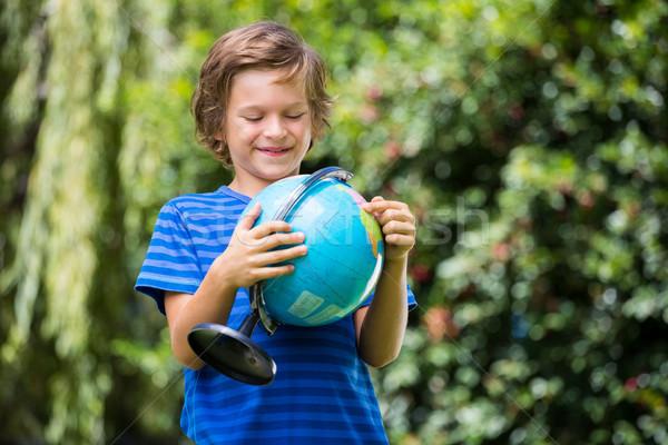 A little boy is holding a globe Stock photo © wavebreak_media