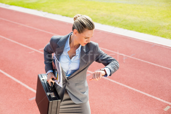 Businesswoman with briefcase in ready to run position Stock photo © wavebreak_media