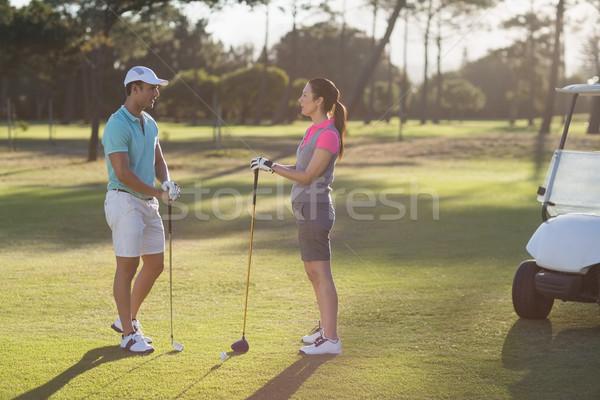 Teljes alakos golfozó pár áll mező nő Stock fotó © wavebreak_media