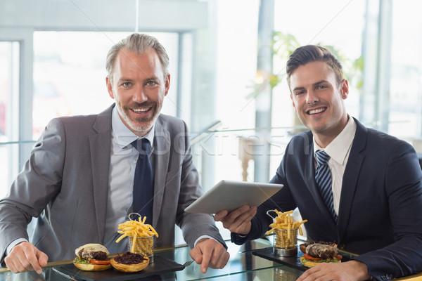 Portrait of businessmen using digital tablet in restaurant Stock photo © wavebreak_media