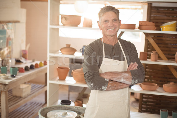 Sorridente masculino em pé cerâmica retrato Foto stock © wavebreak_media