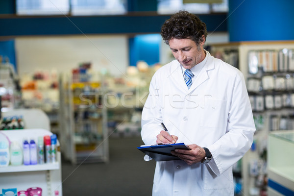 Pharmacist writing on clipboard Stock photo © wavebreak_media