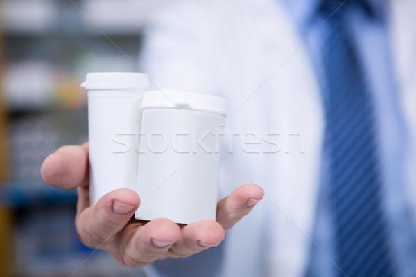 Stock fotó: Gyógyszerész · tart · üvegek · drog · gyógyszertár · üzlet