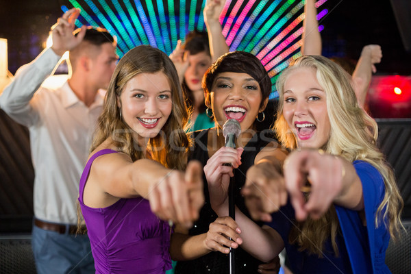 Női barátok énekel dal együtt bár Stock fotó © wavebreak_media