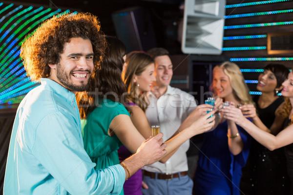 Grupo amigos tequila bar sonriendo mujer Foto stock © wavebreak_media