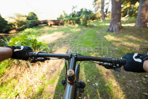 Stock photo: Close-up of male mountain biker riding bicycle