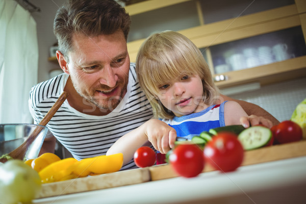 Father and daughter chopping vegetables in kitchen Stock photo © wavebreak_media