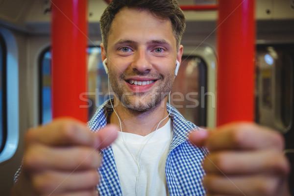 Portré jóképű férfi hallgat zene vonat szeretet Stock fotó © wavebreak_media