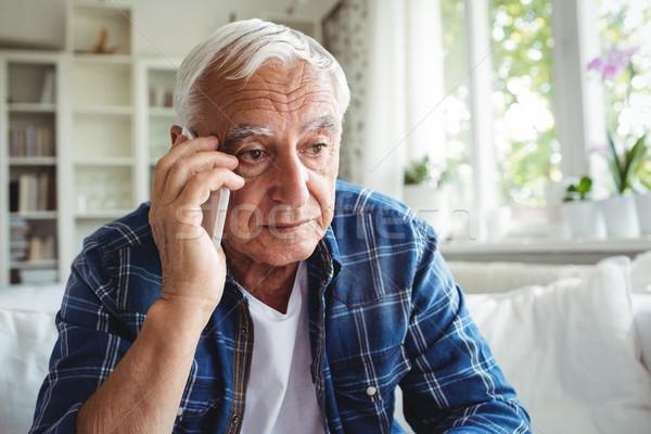 Senior homem falante telefone móvel casa feliz Foto stock © wavebreak_media