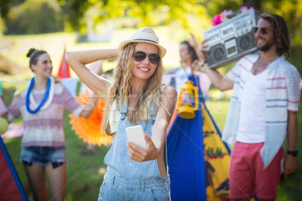 Woman taking selfie at campsite Stock photo © wavebreak_media