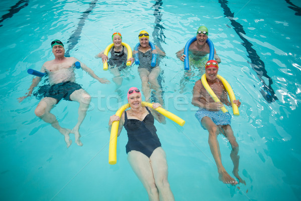 Swimmers swimming with pool noodles Stock photo © wavebreak_media