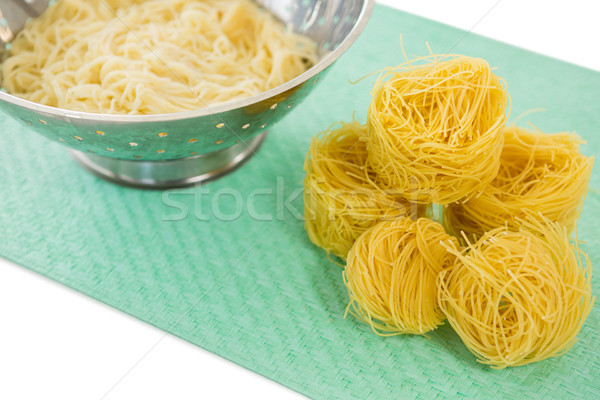 High angle view of pasta in colander with tagliolini on place mat Stock photo © wavebreak_media