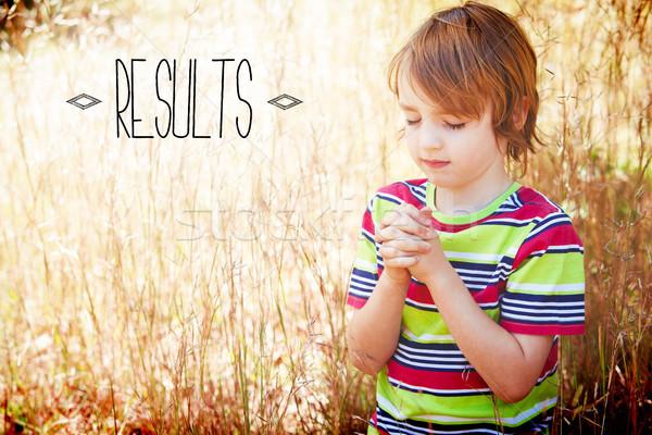 Results against praying little boy in the park Stock photo © wavebreak_media