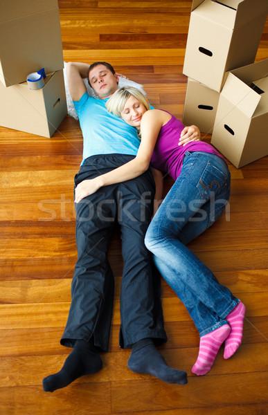 Couple sleeping on the floor. Moving house Stock photo © wavebreak_media