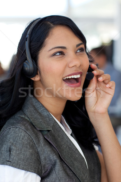 Ethnic businesswoman in a call center Stock photo © wavebreak_media