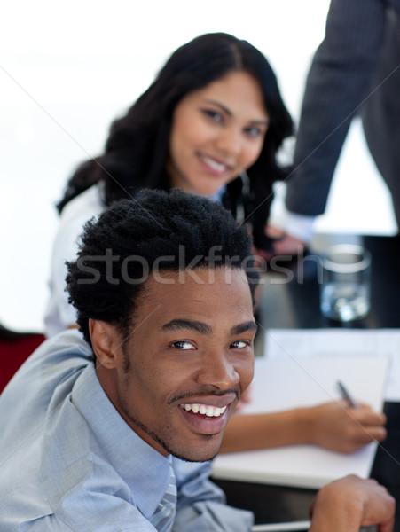 笑みを浮かべて ビジネスマン 会議 同僚 コンピュータ 男 ストックフォト © wavebreak_media