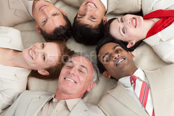 Business team lying on the floor with heads together Stock photo © wavebreak_media