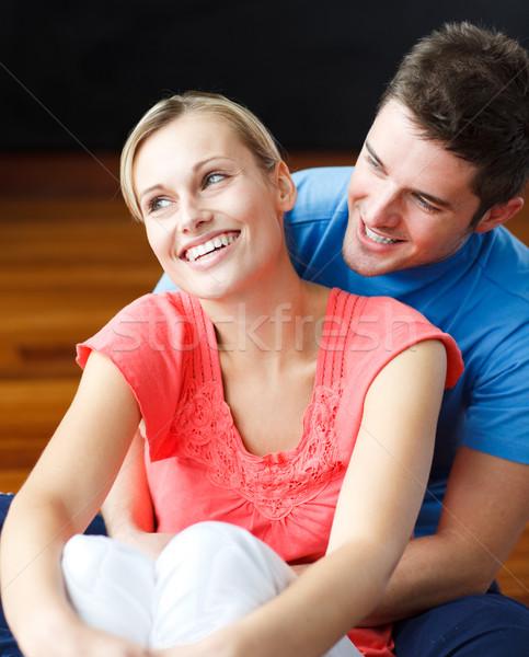 Szerelmespár ül új ház fiatal padló mosoly Stock fotó © wavebreak_media