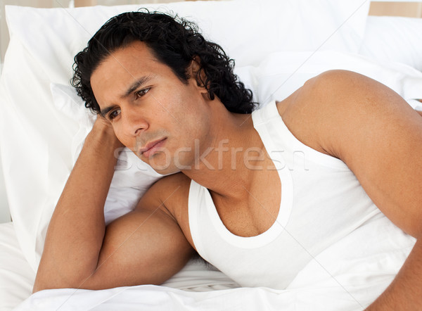 Angry man lying in the bed  Stock photo © wavebreak_media