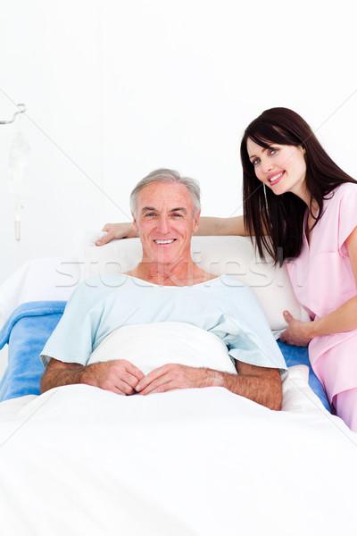 Caring nurse adjusting pillows for a senior patient Stock photo © wavebreak_media