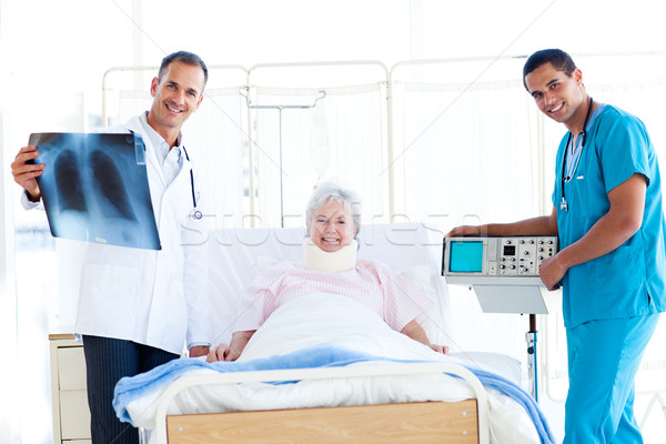 Stock photo: Senior patient looking at an x-ray with her doctor