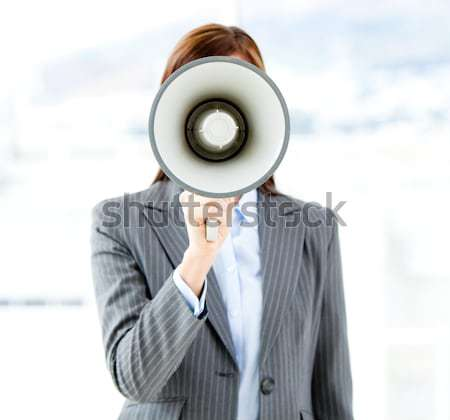 Portrait of a businesswoman shouting through megaphone Stock photo © wavebreak_media