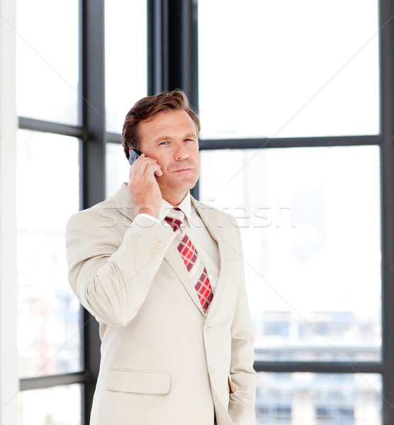 Senior businessman speaking on a mobile phone Stock photo © wavebreak_media