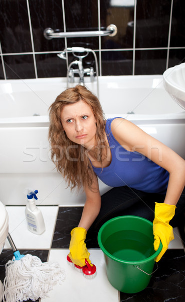 Angry woman in a bathroom cleaning the ground Stock photo © wavebreak_media