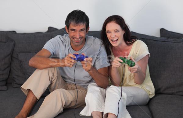 Nevet pár nappali videojátékok nő otthon Stock fotó © wavebreak_media